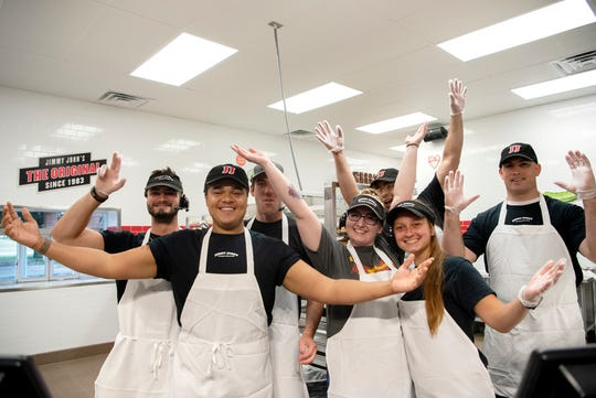 The new Jimmy John's staff poses for a picture during their grand opening on Tuesday, Aug. 6, 2019 in Battle Creek, Mich.