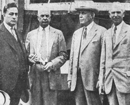Officials watching the parade of trolleys included, from left, J.J. Stratton, president of Triple Cities Traction; Vine Burley, vice president; J.H. Parker, chairman of the Utility Management Corp.; and Walter Morse, president of City National Bank.