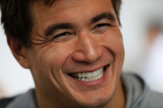 Nathan Adrian, a swimmer from the United States, smiles during an interview at the swimming complex of the Pan American Games in Lima, Peru, Monday, Aug. 5, 2019. Adrian is competing at the Pan American Games just months after being diagnosed with testicular cancer. He has decided to continue training with the goal of competing at Tokyo 2020 Summer Olympics.