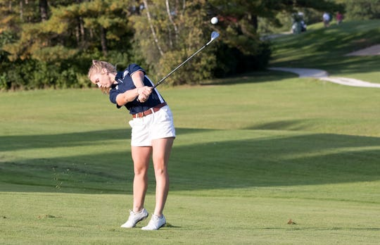 Chloe Levins hits an approach shot during competition with the Middlebury College women's golf team.