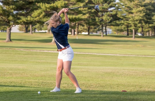 Chloe Levins tees off during competition with the Middlebury College women's golf team.