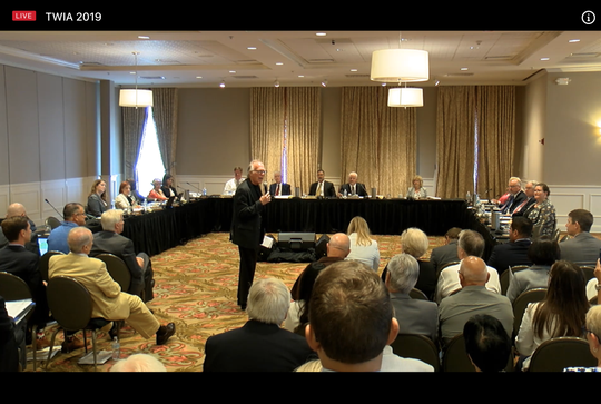 State Rep. Todd Hunter, R-Corpus Christi, addresses those gathered for a Texas Windstorm Insurance Association Board of Directors meeting in Galveston on Aug. 6, 2019.