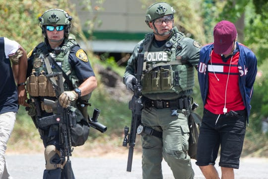 Corpus Christi police take 3 juveniles in to custody following a standoff in the 2800 block of Ayers Street on Tuesday, Aug. 6, 2019.