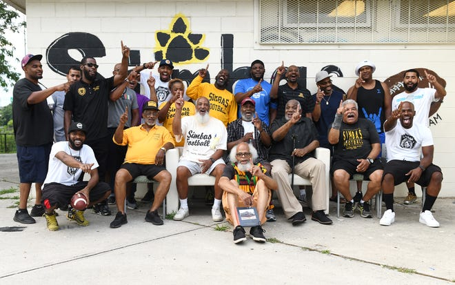 Current and former Centerville Simbas coaches and founders gather together for a photograph with at their football facility in Camden on Friday, August 2, 2019 .  The Centerville Simbas are entering their 50th season this year.