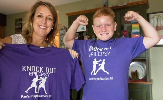 Paul St. Pierre, 12 of Maple Shade, who was recently diagnosed with epilepsy, stands with Beth Norcia, the superintendent of Maple Shade Schools.  Paul and his mother, Colleen Quinn, have established a non-profit called Paul's Purple Warriors NJ to raise awareness for the disease.