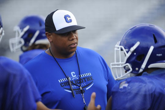 Doug Pryor speaks to Chillicothe football players at practice at the Obadiah Harris Family Athletic Complex in Chillicothe, Ohio on Aug. 6, 2019.