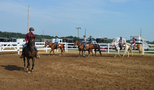 Tuesday's Jr. Fair Horse Show was divided into two classes 13 and younger and 14 and older. The contestants competed in barrel racing and pole bending.