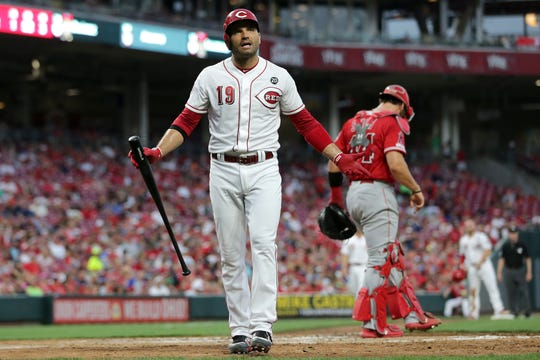 Cincinnati Reds first baseman Joey Votto (19) reacts after striking out with runners in scoring position in the fourth inning of an MLB baseball game against the Los Angeles Angels, Monday, Aug. 5, 2019, at Great American Ball Park in Cincinnati.