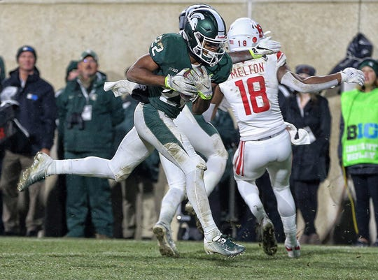 Nov 24, 2018; East Lansing, MI, USA; Michigan State Spartans cornerback Josiah Scott (22) makes a interception against the Rutgers Scarlet Knights during the second half of a game at Spartan Stadium. Mandatory Credit: Mike Carter-USA TODAY Sports