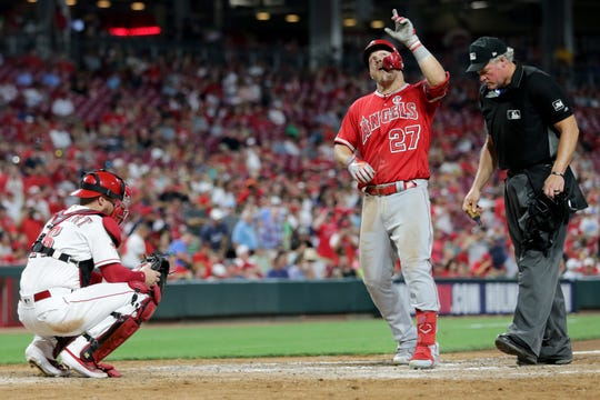 Los Angeles Angels center fielder Mike Trout (27) celebrates after hitting a solo home run in the sixth inning of an MLB baseball game against the Cincinnati Reds, Monday, Aug. 5, 2019, at Great American Ball Park in Cincinnati.