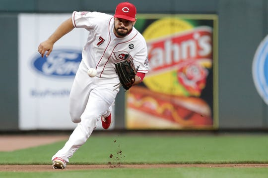 Cincinnati Reds third baseman Eugenio Suarez (7) fields a groundball in the fourth inning of an MLB baseball game against the Los Angeles Angels, Monday, Aug. 5, 2019, at Great American Ball Park in Cincinnati.