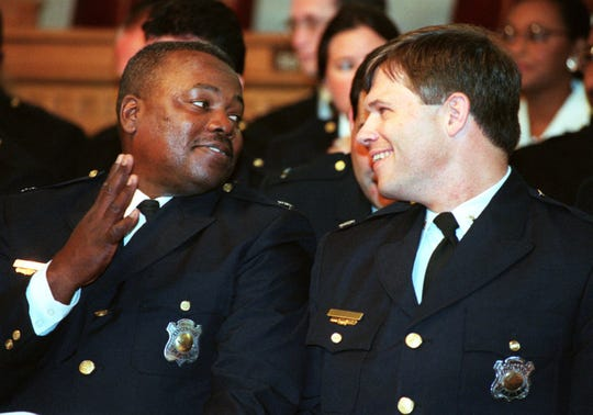 Aug. 27, 1998. Colonel Ronald J. Twitty, left, talks With Lieutenant Colonel Richard S. Biehl, during a promotion ceremony to rank of Assistant Chief. Tony Jones/Enquirer