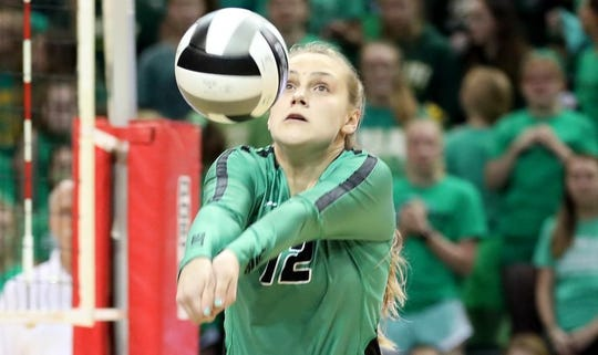 Ursuline player Logan Case (12) during the Lions State semi-final volleyball game against Olentangy Libery on Nov. 9.