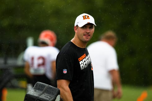 Cincinnati Bengals head coach Zac Taylor looks on as the team walks off the field in the rain during Bengals training camp on Aug. 6, 2019, in Cincinnati.