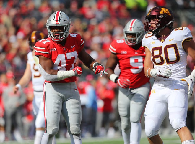 Oct 13, 2018; Columbus, OH, USA; Ohio State Buckeyes linebacker Justin Hilliard (47) celebrates a tackle during the second half against the Minnesota Golden Gophers at Ohio Stadium. Mandatory Credit: Joe Maiorana-USA TODAY Sports