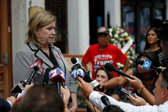 Dayton mayor Nan Whaley gives a brief press conference in front of Ned Pepper's Bar in the Oregon District of Dayton, Ohio, on Tuesday, Aug. 6, 2019.
