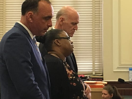 Tiffany Smith stands between her attorneys, Richard Vande Ryt, at left, and Stephen Wenke, during her sentencing Tuesday, Aug. 6, 2019 in Hamilton County Common Pleas Court.
