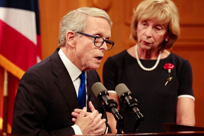 Ohio Gov. Mike DeWine answers a question during a press conference regarding the Dayton Mass Shooting on Tuesday, Aug. 6, 2019 at the Ohio Statehouse in Columbus, Ohio.  Facing pressure to take action after the latest mass shooting in the U.S., DeWine urged the GOP-led state Legislature Tuesday to pass laws requiring background checks for nearly all gun sales and allowing courts to restrict firearms access for people perceived as threats. (Joshua A. Bickel /The Columbus Dispatch via AP)