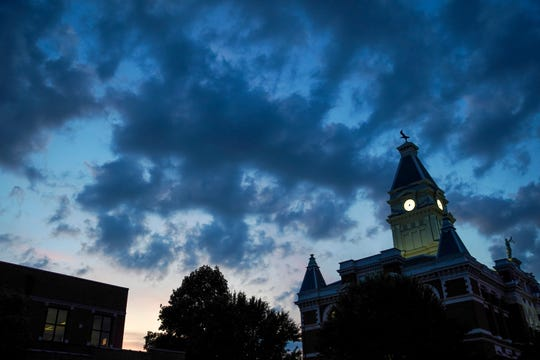 The historic Montgomery County Courthouse can be seen silhouetted in late evening from across the street at 200 Commerce Street in Clarksville, Tenn., on Monday, Aug. 5, 2019.