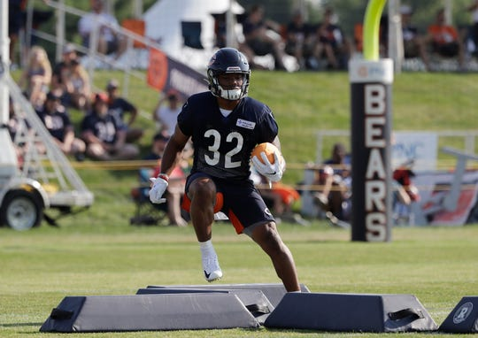 Chicago Bears running back David Montgomery works on the field during an NFL football training camp in Bourbonnais, Illinois, on Saturday, July 27, 2019.
