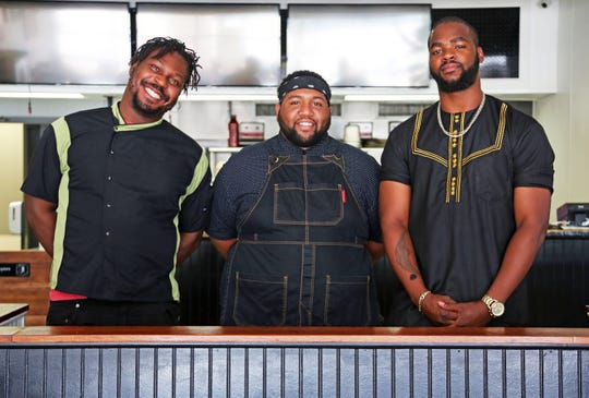 YumVillage Chef-Owner Godwin Ihentuge, left, with Davante Burnley and Justice Akuezue of The Exchange. The trio will be cooking a collaborative dinner Sunday, August 18, 2019, to kickoff Detroit Black Restaurant Week and The Exchange's residency at YumVillage.