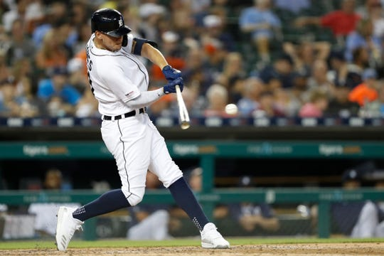 Aug 5, 2019; Detroit, MI, USA; Detroit Tigers center fielder JaCoby Jones (21) hits for a triple during the fifth inning against the Chicago White Sox at Comerica Park. Mandatory Credit: Raj Mehta-USA TODAY Sports