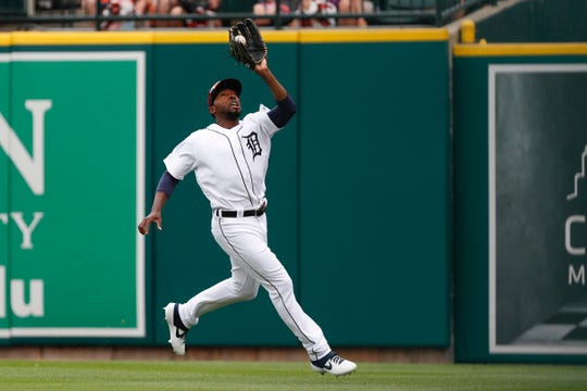 Aug 6, 2019; Detroit, MI, USA; Detroit Tigers right fielder Travis Demeritte (50) makes a catch for an out during the first inning against the Chicago White Sox at Comerica Park. Mandatory Credit: Raj Mehta-USA TODAY Sports