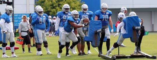Lions defensive linemen go through drills during joint practice in training camp on Tuesday, Aug. 6, 2019, in Allen Park.