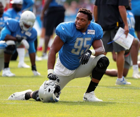 Lions defensive end Romeo Okwara stretches during joint practice in training camp on Tuesday, Aug. 6, 2019, in Allen Park.