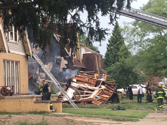Firefighters dig through remains of a home on Haverhill on Detroit's east side on Tuesday, Aug. 6, 2019.