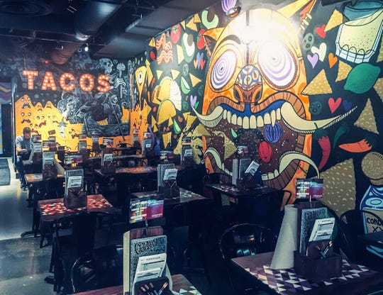 The murals on the walls  inside Condado Tacos in Royal Oak were painted by local artists.
