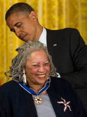 In this May 29, 2012 file photo President Barack Obama awards author Toni Morrison with a Medal of Freedom, during a ceremony in the East Room of the White House in Washington.