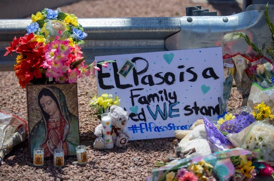 Flowers and a Virgin Mary painting adorn a makeshift memorial for the victims of Saturday mass shooting at a shopping complex in El Paso, Texas.