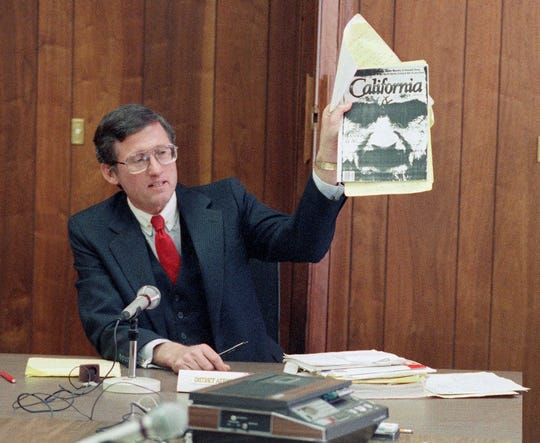 In this Feb. 9, 1989 file photo, Los Angeles Deputy District Attorney Stephen Kay holds up a magazine profiling convicted murderer Charles Manson while delivering his closing statement at Manson's parole hearing at San Quentin Prison, Calif.