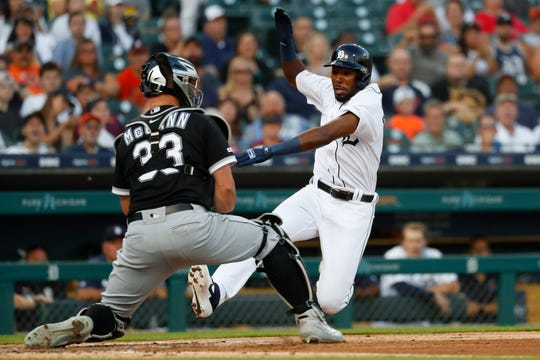 Detroit Tigers' Travis Demeritte slides safely into home plate ahead of the tag by Chicago White Sox catcher James McCann (33) in the second inning of Monday's 7-4 loss.