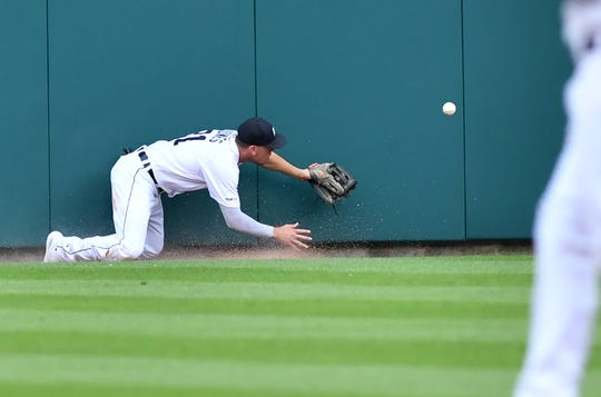 Tigers center fielder JaCoby Jones makes a catch but then it pops out of his glove in the second inning Tuesday.
