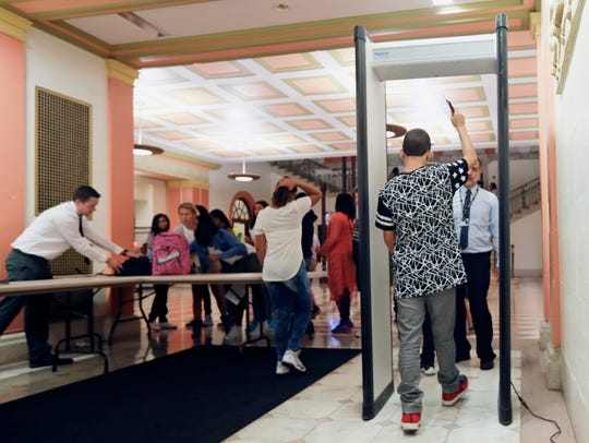 Students at William Hackett Middle School pass through metal detectors on the first day of school in 2016 in Albany, N.Y. Schools around the country have been setting up teams to assess threats posed by students who display signs of violence.