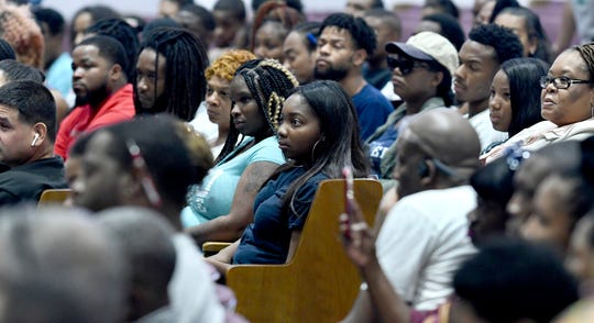 The audience listens as Mayor Mike Duggan talks to Detroit residents about job opportunities with Fiat Chrysler during a readiness event in Detroit on Tuesday.