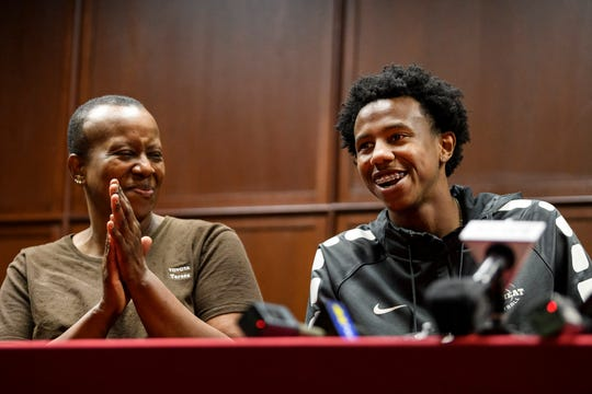 Teresa Higgins, left, proudly looks on as her son Kiyron Powell, right, announces that he is verbally committing to the University of Houston to play basketball during a press conference held at Bosse High School's Fine Arts Gallery in Evansville, Ind., Tuesday, Aug. 6, 2019. Due to NCAA rules, he cannot sign his letter of intent until November.