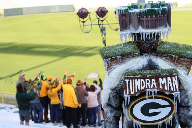 """Jeff Kahlow of Big Guy Hats in Fond du Lac dresses in full """"Frozen Tundra Man"""" gear to film a commercial at Lambeau Field in Green Bay for Wisconsin Lottery's new Packers scratch game tickets."""
