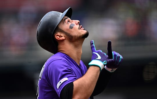 Colorado Rockies third baseman Nolan Arenado celebrates after hitting a solo home run in an Aug. 4, 2019, game against the San Francisco Giants at Coors Field. Arenado and the Rockies wrap up a two-game series in Houston with a 12:10 p.m. game Wednesday against the Astros.