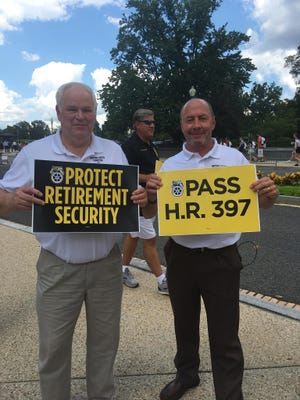 In this file photo from 2019, Terry Black, left, and Brad Vaughn, members of the Wisconsin/Green Bay Committee to Protect Pensions traveled to Washington, D.C. in July to watch the House of Representatives pass the a pension reform bill called the Butch Lewis Act.