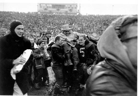 Green Bay coach Vince Lombardi is carried off of Lambeau Field on the shoulders of fullback Jim Taylor, left, and Paul Hornung after winning the NFL championship against the Cleveland Browns, 23-12, on Jan. 2, 1966.