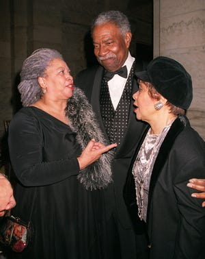 Nobel Prize winning writer Toni Morrison, left, shares a moment with actors and activist Ossie Davis, center, and his wife Ruby Dee during a 70th birthday tribute for Morrison hosted by the Toni Morrison Society and Alfred A. Knopf Saturday, Feb. 17, 2001, in New York.  (AP Photo/Darla Khazei)