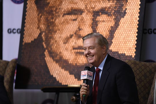 """Sen. Lindsey Graham speaks with reporters at the Greenville County Republican Party's second-annual """"Washington Night"""" event earlier this year."""