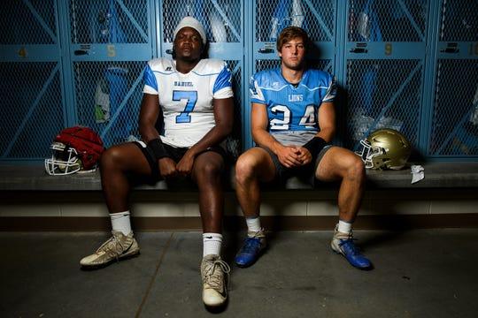Daniel defensive end Jared Kirksey, left, and quarterback Tyler Venables pose for a portrait in their locker room Monday, Aug. 5, 2019.