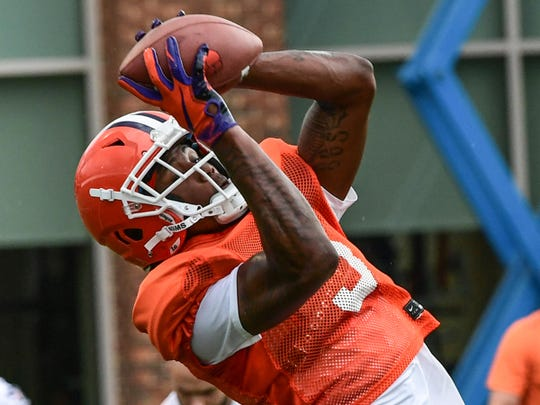 Clemson wide receiver Tee Higgins (5) catches a pass during practice at the Allen N. Reeves Football Complex Monday, August 5, 2019.