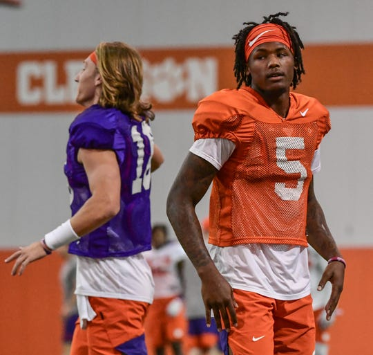 Clemson quarterback Trevor Lawrence (16) and Clemson wide receiver Tee Higgins (5) during practice at the Allen N. Reeves Football Complex Monday, August 5, 2019.