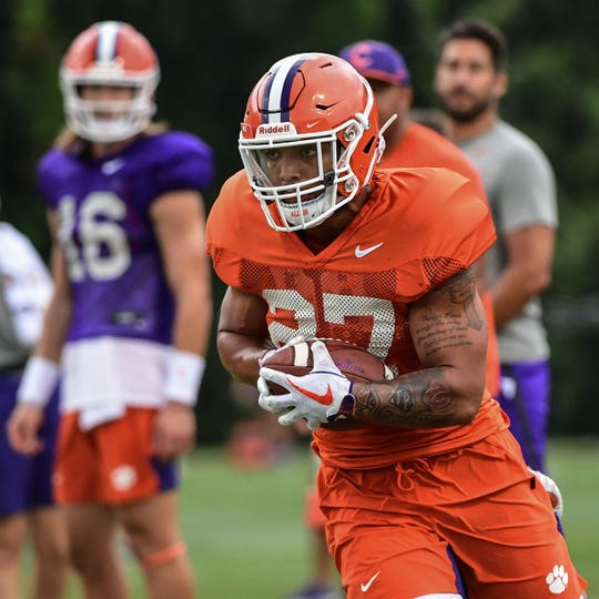 Clemson running back Chez Mellusi(27) runs after a catch during practice at the Allen N. Reeves Football Complex Monday, August 5, 2019.
