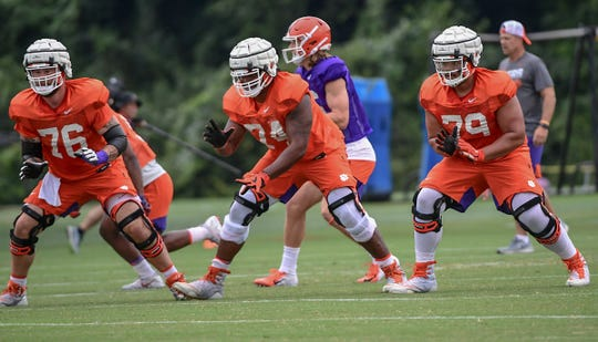 Clemson offensive lineman Sean Pollard (76), left, offensive guard John Simpson (74), and offensive lineman Jackson Carman (79) during practice at the Allen N. Reeves Football Complex Monday, August 5, 2019.